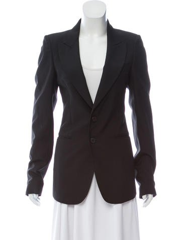 https://www.therealreal.com/products/women/clothing/jackets/balenciaga-wool-structured-blazer-fMrXZjAGU7Q
