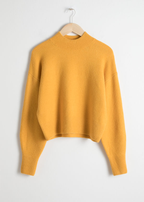 https://www.stories.com/en_usd/clothing/knitwear/product.mock-neck-cropped-sweater-yellow.0669973001.html