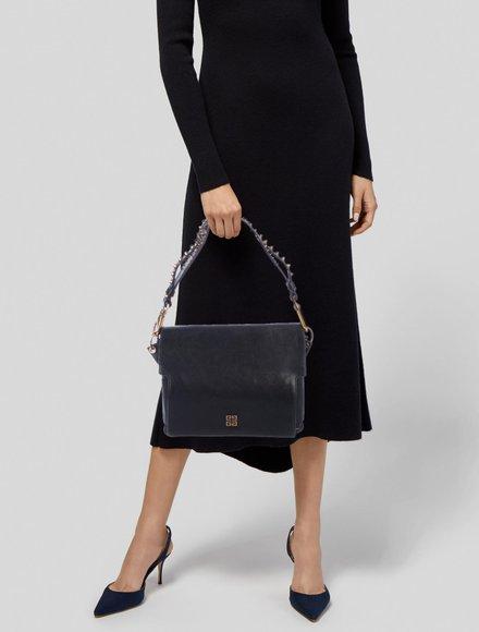 https://www.therealreal.com/phoenix/products/women/handbags/shoulder-bags/givenchy-studded-melancholia-shoulder-bag