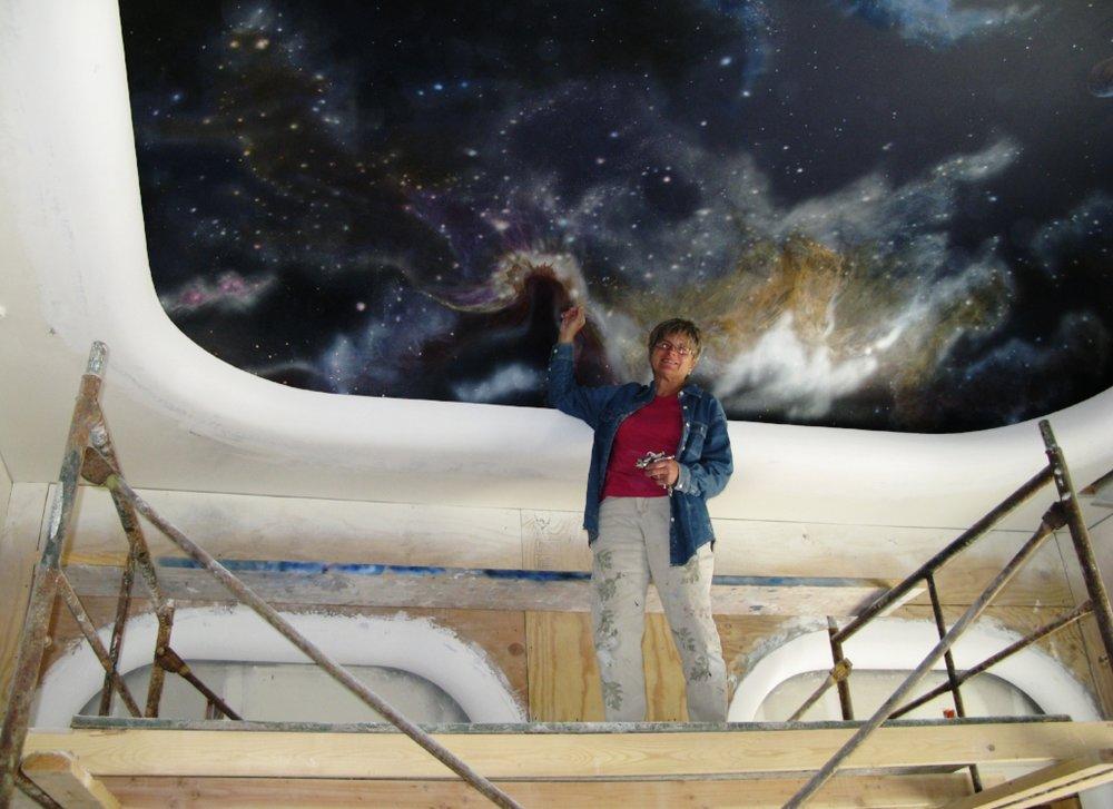 Marcie Painting Galaxy Mural.jpg