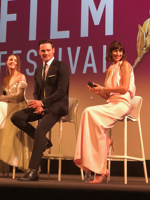Actors from left to right, Sophie Skelton (Brianna Randall Fraser), Sam Heughan (Jamie Fraser), and Caitriona Balfe (Claire Randall Fraser), photo credit Alaina Minichiello