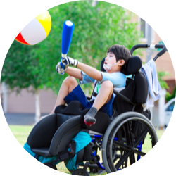 Boy in wheelchair playing ball