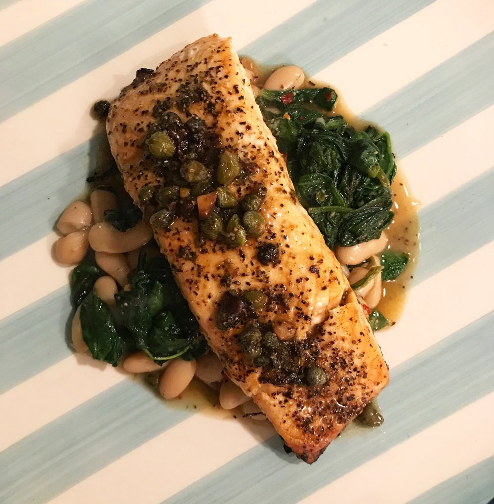 Grilled Salmon in White Wine Caper Sauce with Tuscan Beans   This easy, healthy meal will become your weeknight staple.