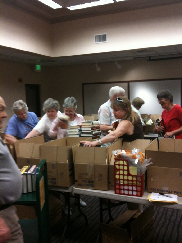 Volunteers at the Mercer Island Library unloading boxes of donated books before a book sale in 2009.