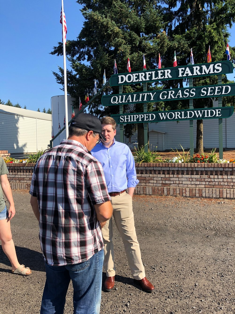 Speaking with Kent Doerfler outside of his grass seed packaging facility.