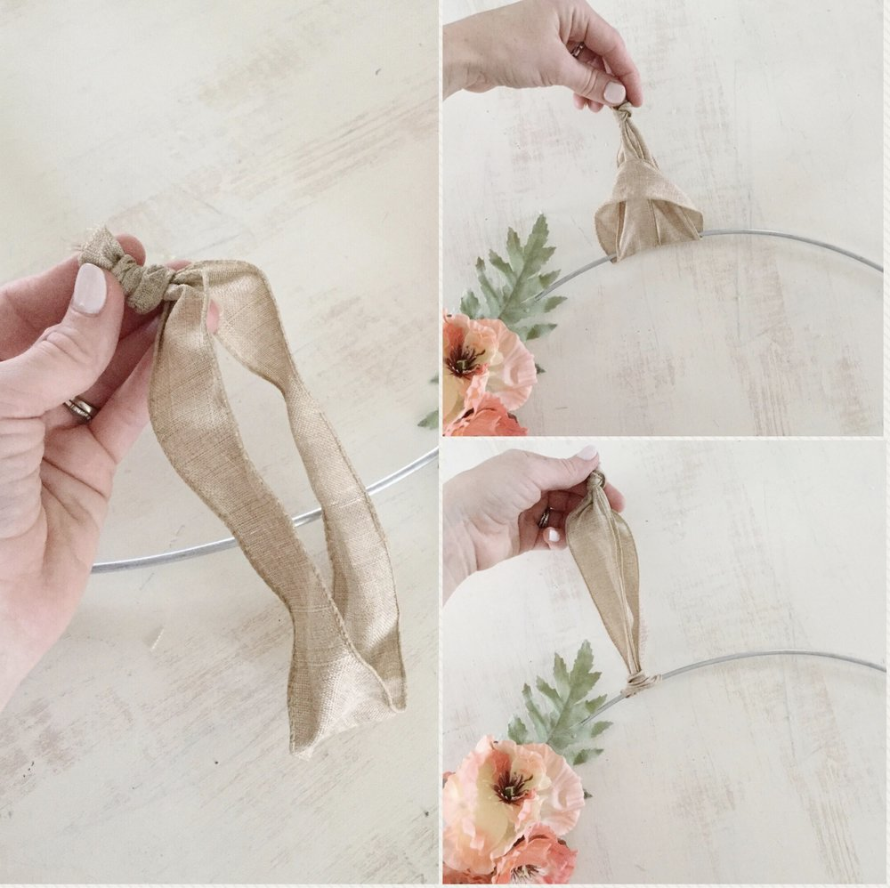 Step 6: Attach ribbon - Finally, you'll want to attach ribbon or twine to your floral hoop in order to hang it. You can do this a number of ways but for something simple, tie the ends of a strip of ribbon into a knot. With the floral hoop laying on the knotted ribbon, loop the knot back through the ribbon and then pull it tight. You can manipulate the ribbon when you hang the floral hoop so that the knot can't be seen.