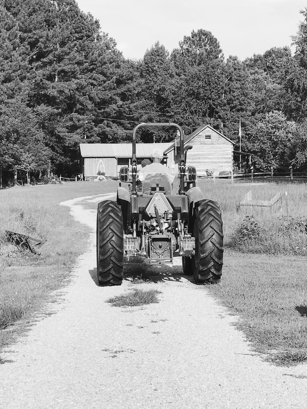 Within seconds of us pulling into Uncle Bill and Aunt Mildred's driveway, Bo was begging to ride Uncle Bill's new tractor. His little 3-year-old self was pleased as punch when He finally got what he'd been talking about since the last time we were all in Alabama back in October.