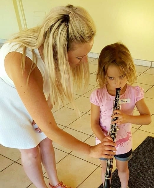 girl eating oboe.jpg