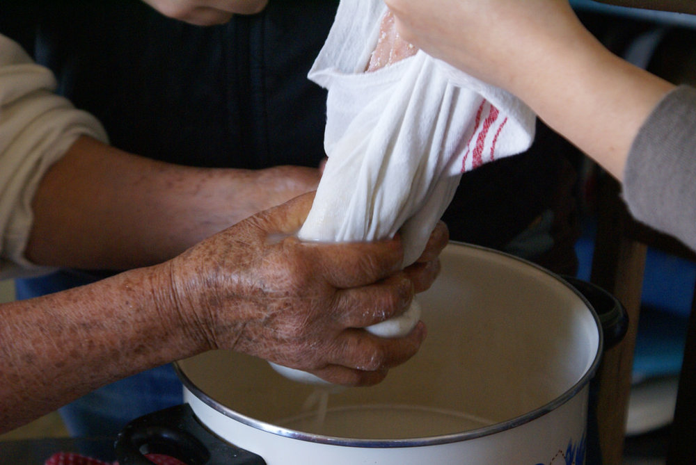 4. Champurrado (Chocolate Atole). Señora Soledad demonstrates a traditional method for making Champurrado, photo by Ryan Pikkel