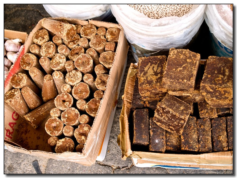 Piloncillo and Chocolate in the market in Oaxaca, MX. Photo by Waywuwei.