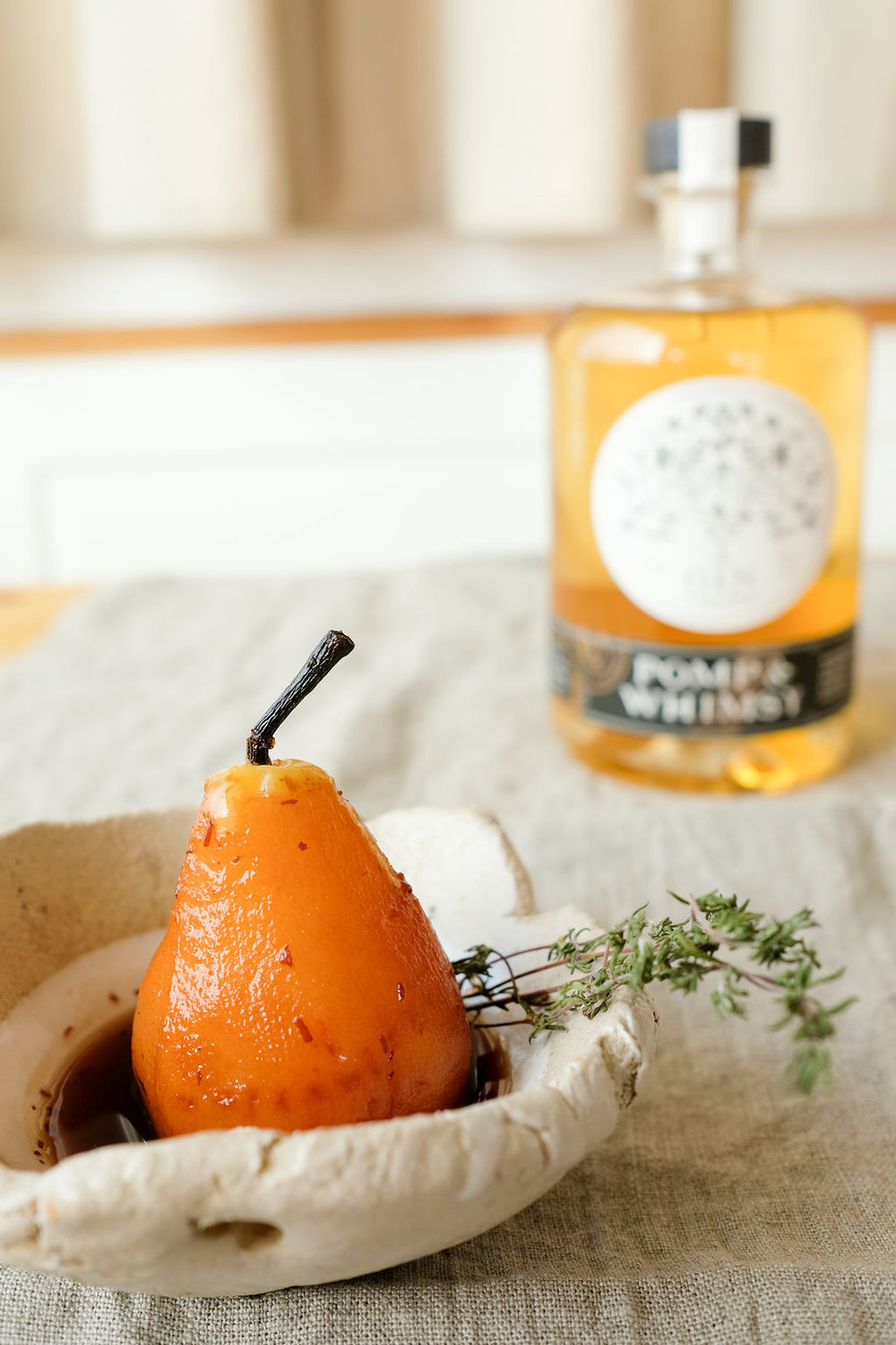 POMP & WHIMSY GIN LIQUER    Pomp & Whimsy, bringing modern sensibilities to the tradition of gin making, by infusing classically distilled gin with a natural, delightfully flavorful botanical liqueur.  The result is a highly refined, yet playfully sensorial spirit, that is both graceful by itself, and effortlessly dressed, up or down.   Photo by Bessie Lacap, Torn Bowl available through    Piece of Clay