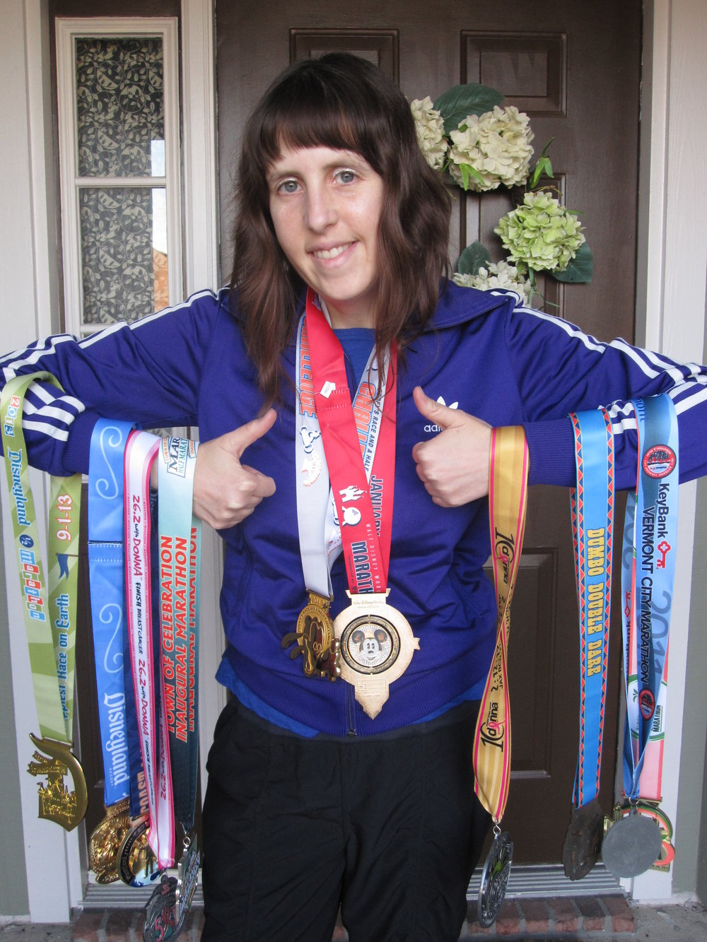 Emily and some of her race medals