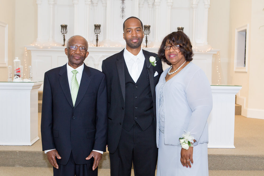 Anthony with his parents on our wedding day