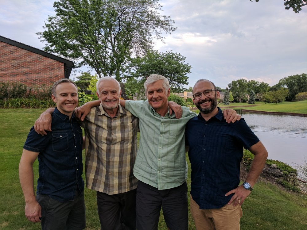Andy with his dad, uncle and brother before a family dinner