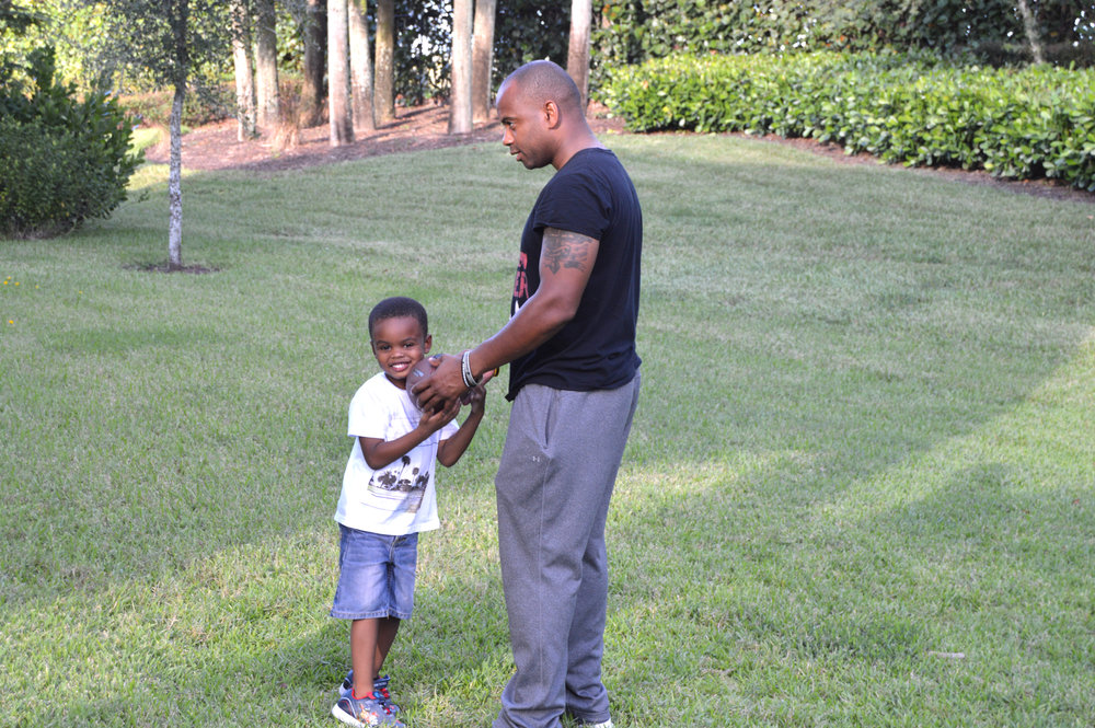 Playing football in the back yard with Zion
