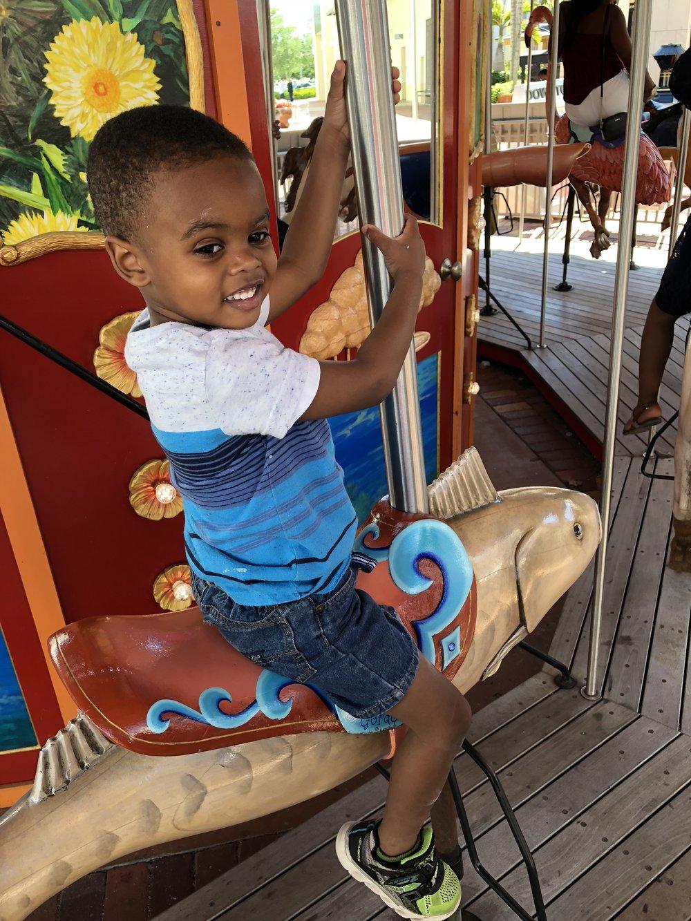 Zion enjoying the carousel