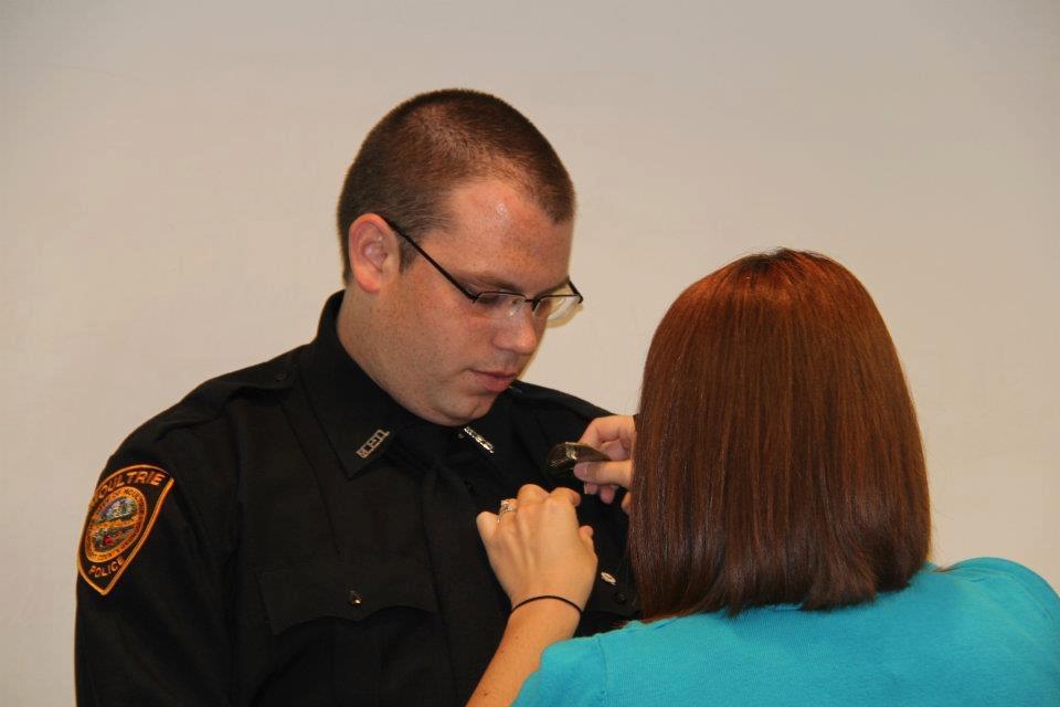 Ashley pinning Joshua with his badge!.JPG