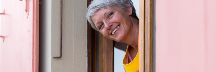 Happy grey-haired woman