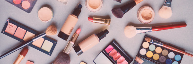 Makeup scattered on table