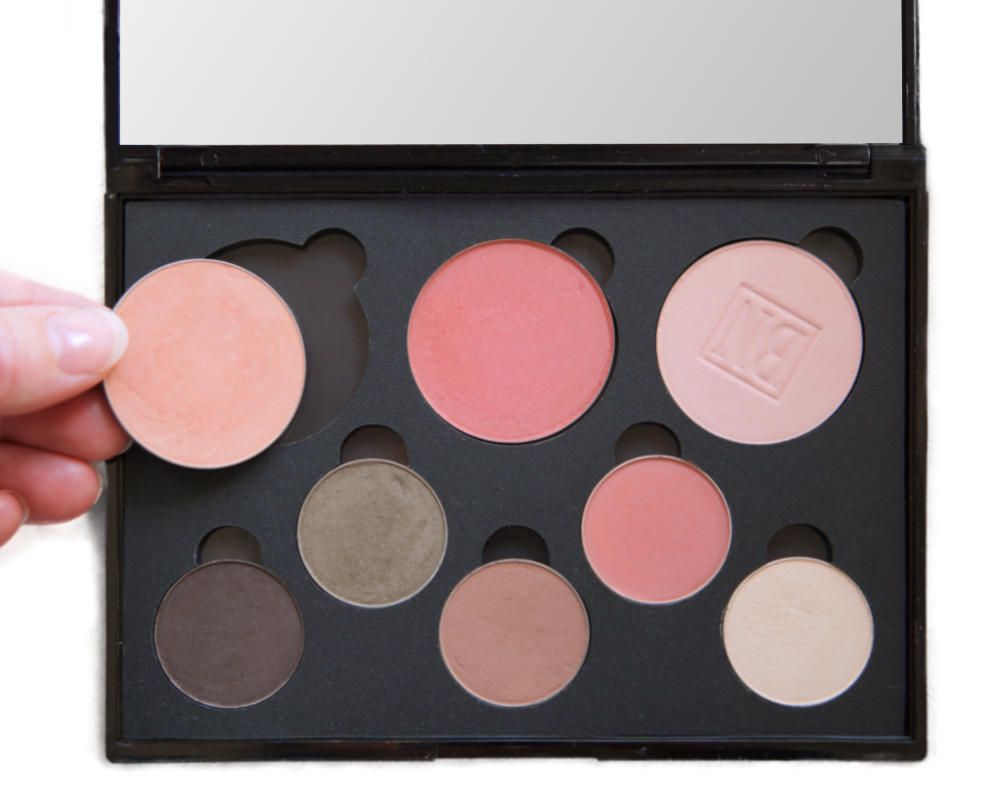 Custom makeup palette containing eyeshadows and blushes in Soft Autumn colours