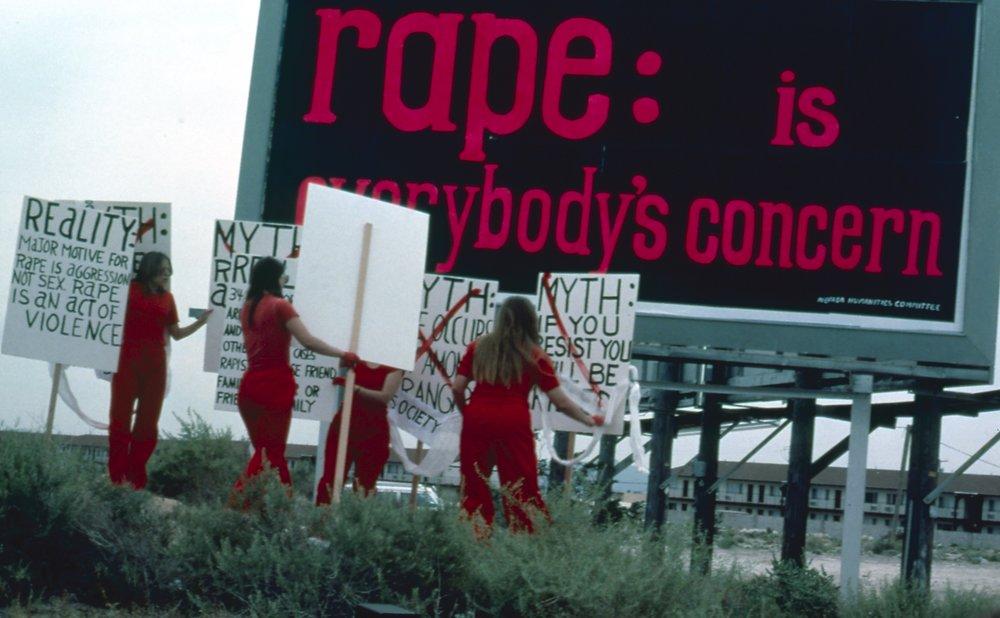 Leslie Labowitz performance  Myths About Rape , press conference.