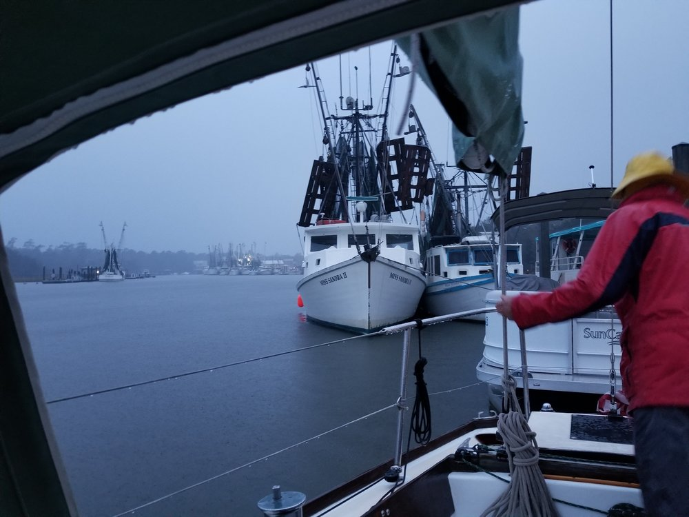Preparing to cast off before dawn in pouring rain, wind, and fog.