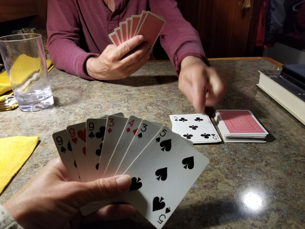 Working toward a winning hand at gin rummy.