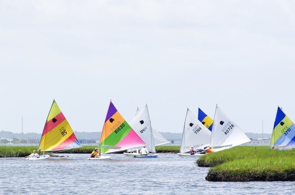 "That's me with the neon pink clew, racing in the 2012 Harker's Island Regatta - 2nd Place in ""Beater"" Class!  Photo credit: My Own Bloody Yacht Club"