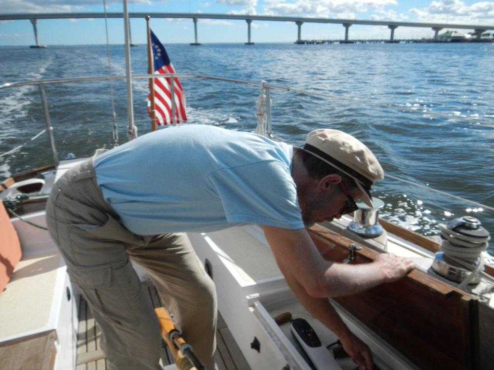 Dobbs stows the autopilot, approaching Titusville Marina.