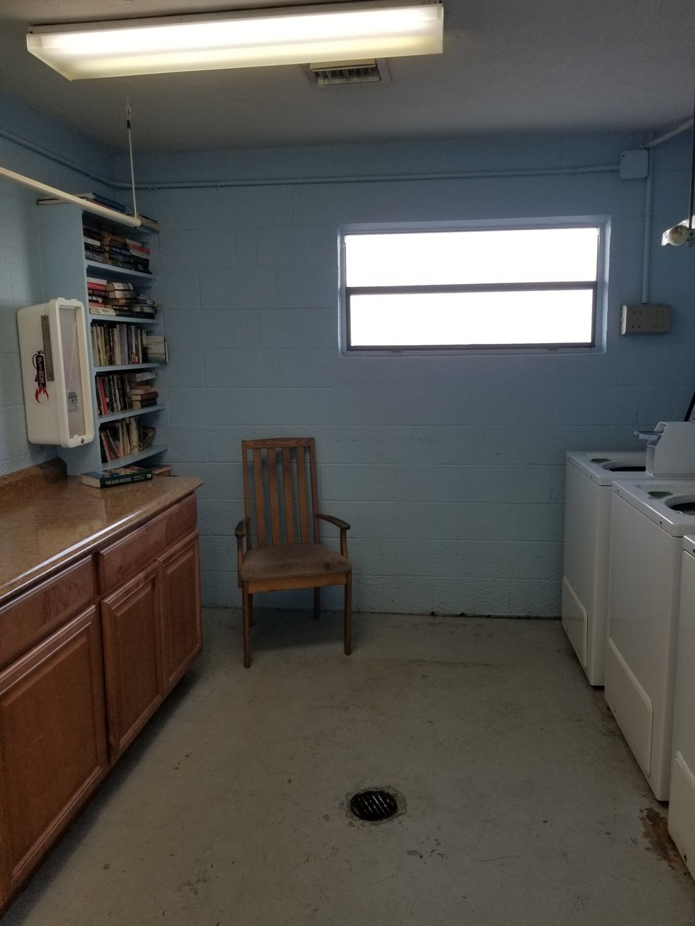 The laundry room. It doesn't look like much, but the chair is pretty comfy and the book swap is a good one!