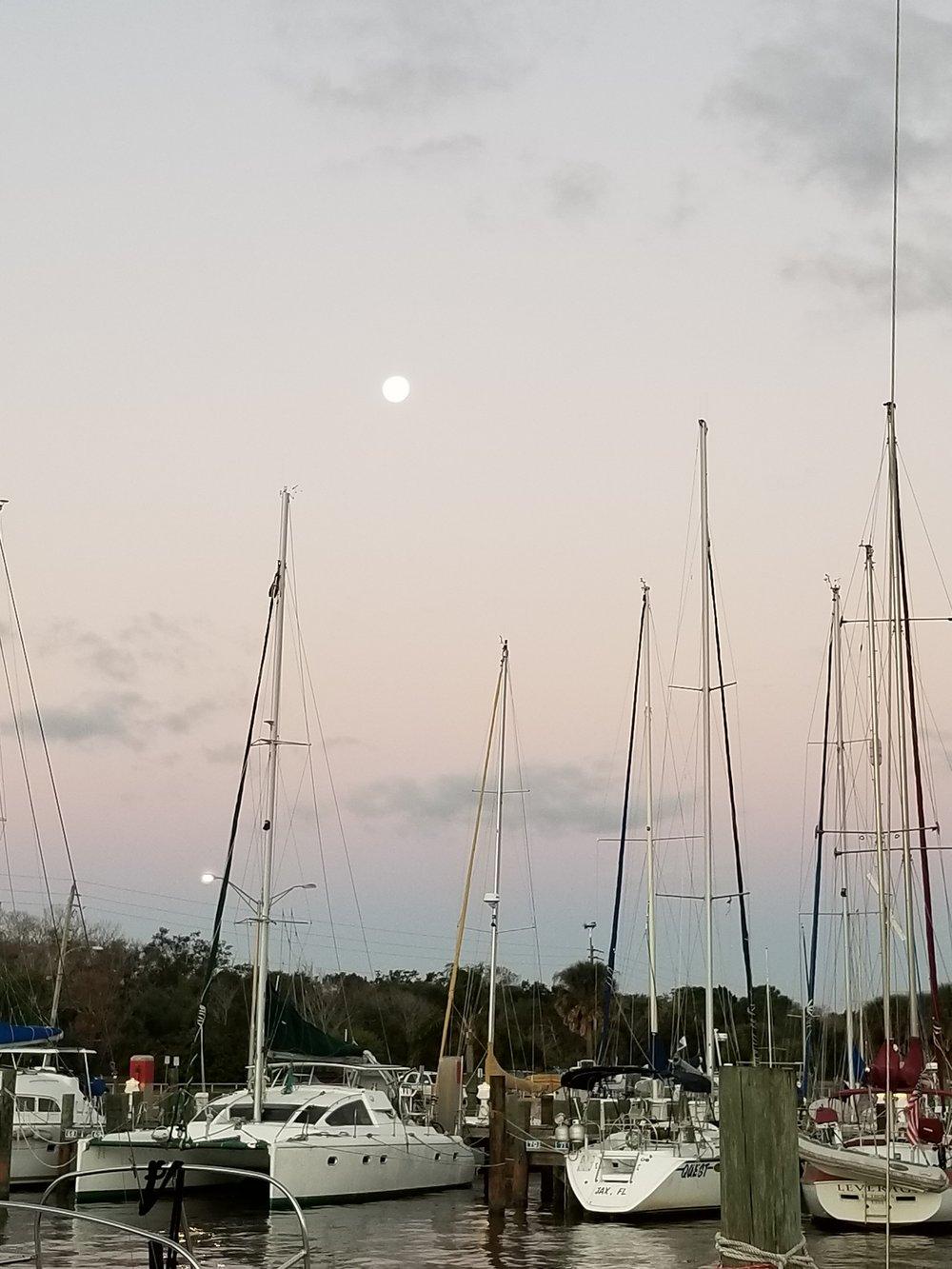 Full moon still shining brightly in the western sky as dawn breaks behind me.