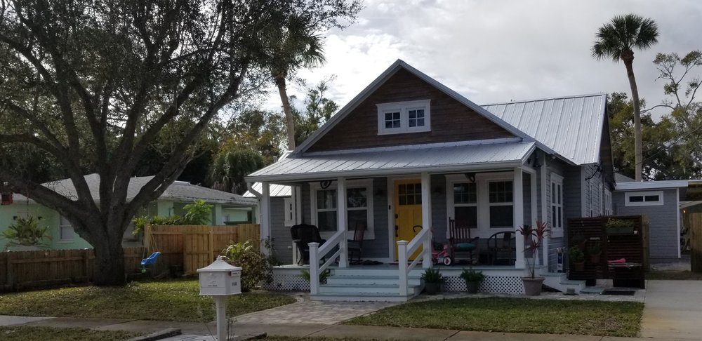 This is one of my two favorites - I love the shape, tin roof, coloring (though not for me), and porch.