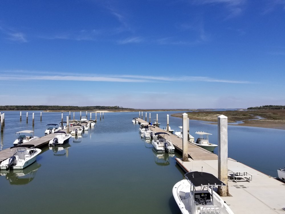 The view from the office porch, overlooking the Freedom Boat Club docks toward Port Royal Sound.