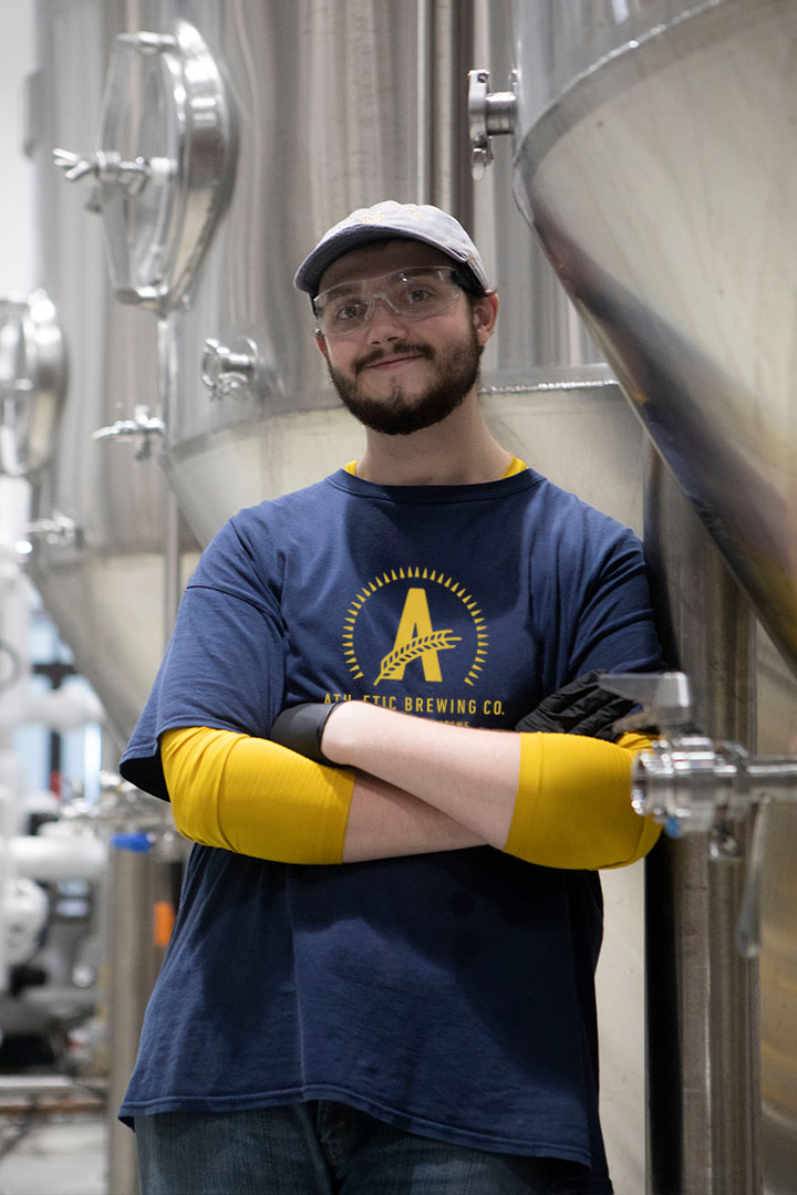 Andrew: Assistant Brewer - A talented chemist and graduate of Notre Dame, Andrew saw the potential in Athletic before we opened our doors for business and has since worn every hat in the building. Most likely to find him with a in his hand.