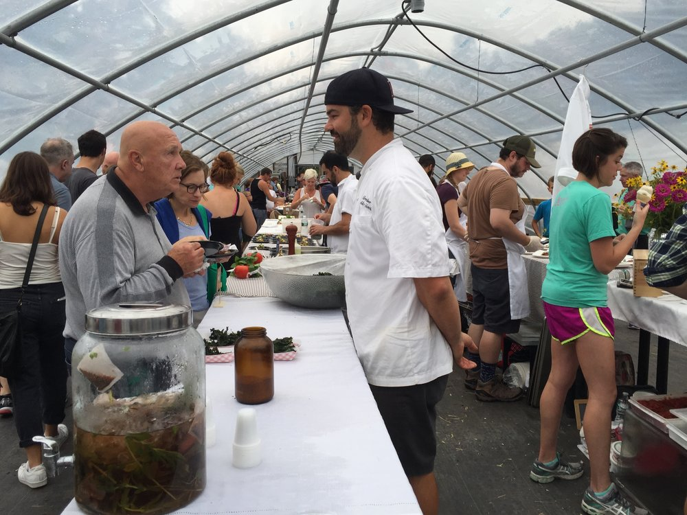 Chef Alden Cadwell speaks with visitor to Allendale Farm Annual Tomato Festival