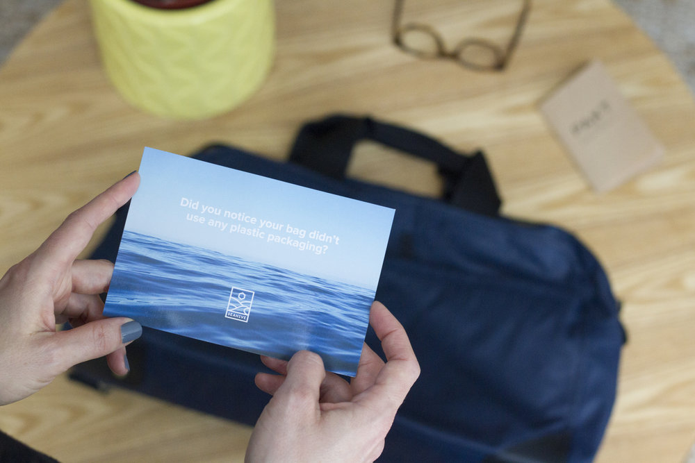 The frontside of a card we made explaining the SeaHive plastic-free packaging for Pakt bags.