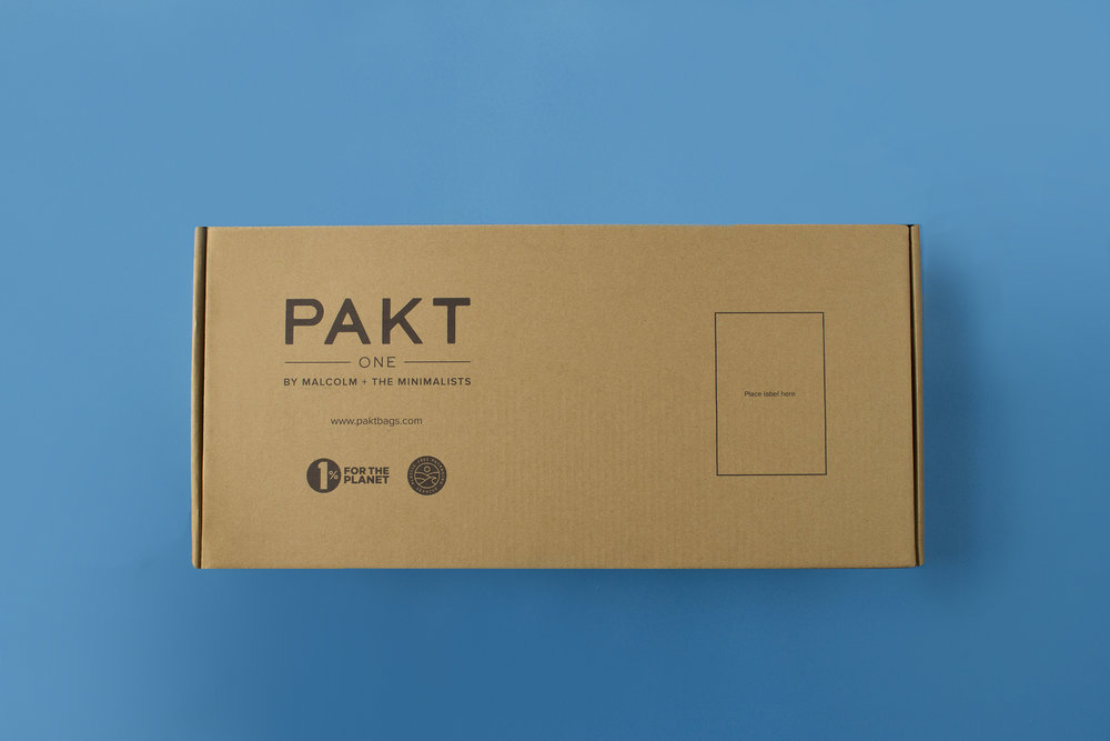 The box is a simple tuck-top design that fits the Pakt One's dimensions perfectly.