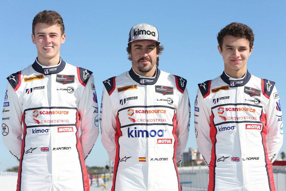 Phil Hanson (left) and Lando Norris (right) with teammate Fernando Alonso at the ROAR Before the 24 test. Photo credit: United Autosports