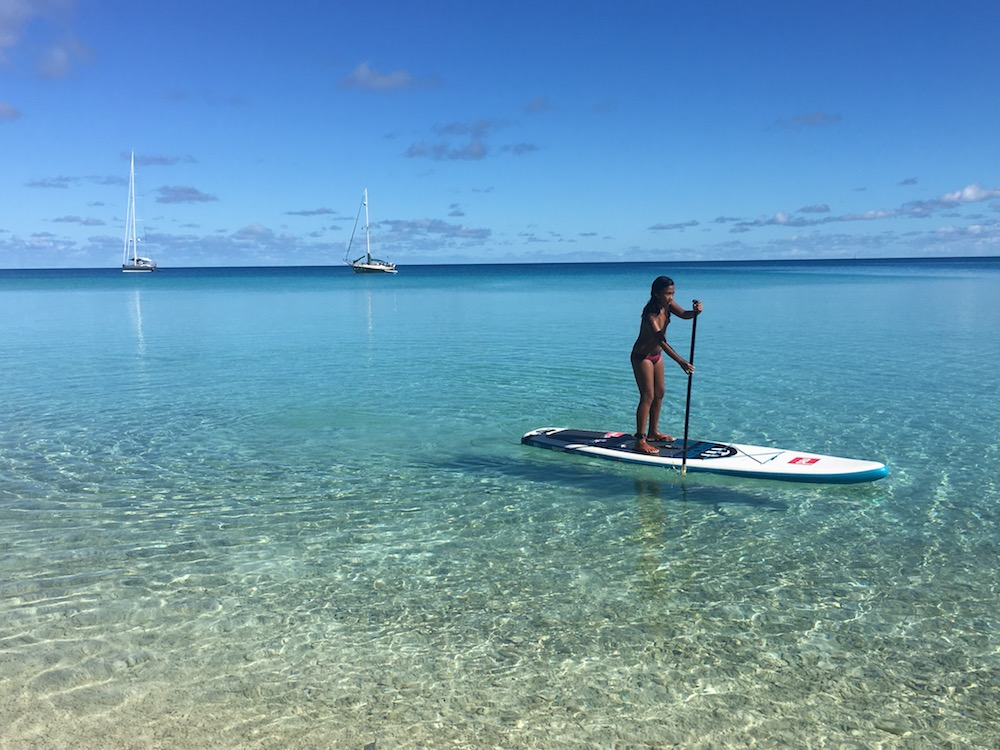 A local girl on Hirifa motu plays around on our inflatable paddle board (you can see Sedna anchored in the background). We enjoyed playing with several kids in this family during a relaxing beach day. The Dad ended up taking Clif spearfishing-- which was a Fakarava highlight!