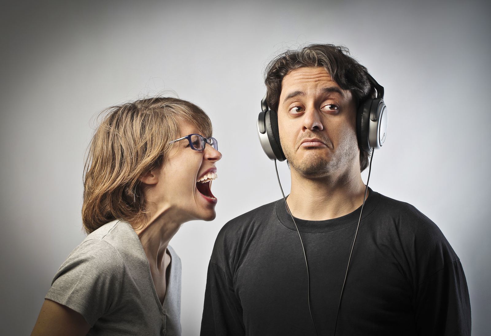 bigstock-Angry-wife-screaming-against-h-32726765