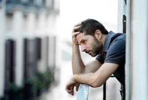 bigstock-Young-Man-At-Balcony-In-Depres-71305003-e1445871061791.jpg