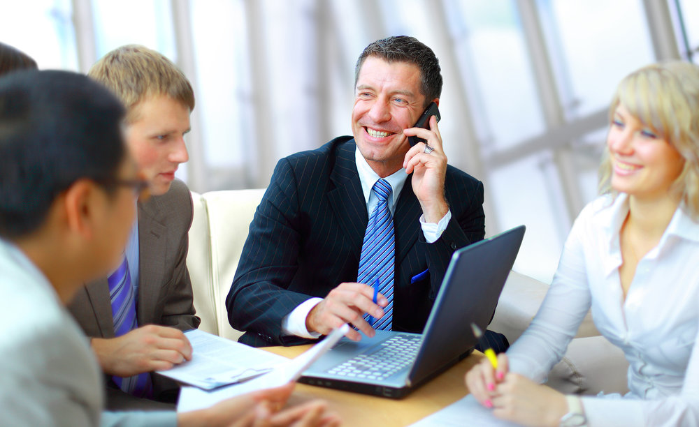 bigstock-business-man-speaking-on-the-p-13871546.jpg