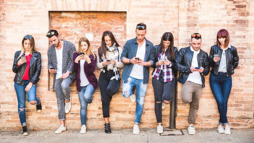 bigstock-Friends-Group-Using-Smartphone-237032062.jpg