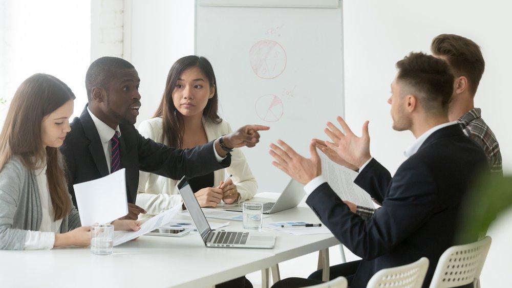 bigstock-Diverse-Employees-Arguing-Duri-240333181.jpg