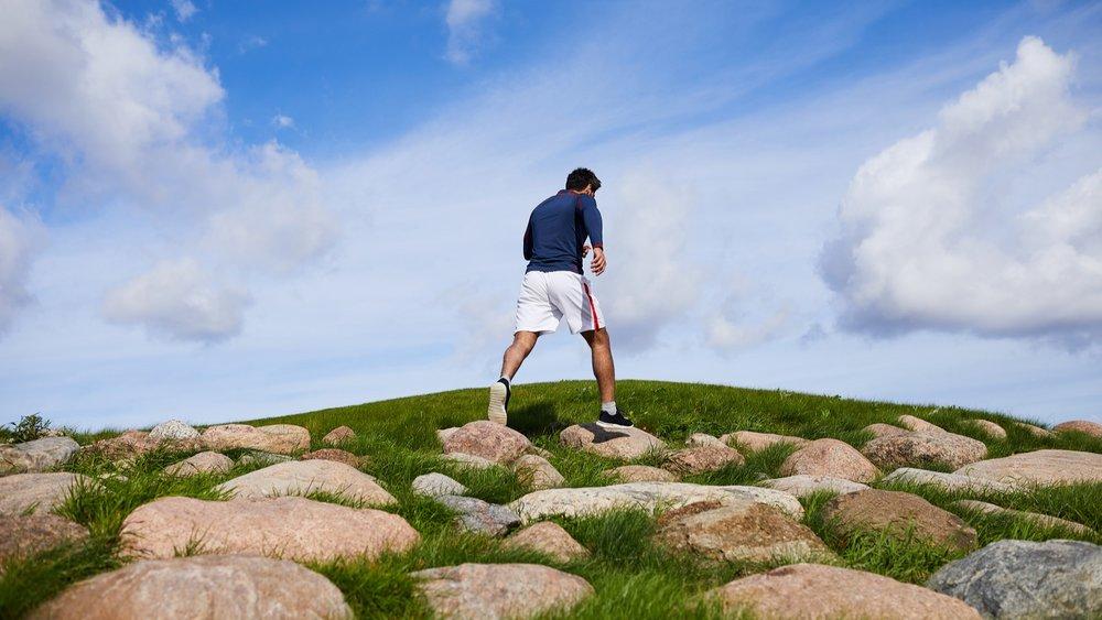 bigstock-Young-man-in-sportswear-walkin-272115076.jpg