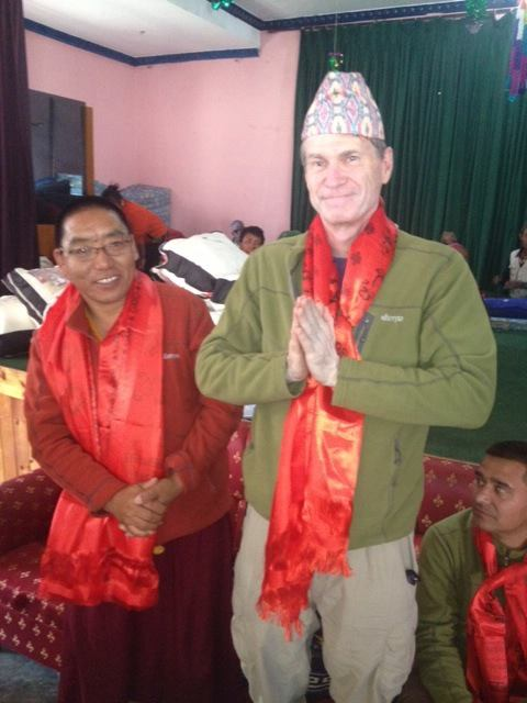 Scott Hamilton, GOS expedition leader, is honored during a community celebration in Marpha, Nepal. The entire team was presented with ceremonial scarves – katas – in thanks for their work.