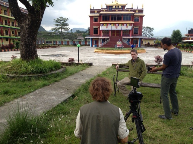 Scott Hamilton conducts his final interview for the documentary on the grounds of the monastery in Pokhara.
