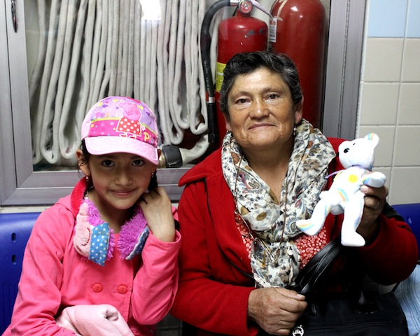 Patients pose with little toys and treats we passed out in the hallway as they waited to see the doctors.