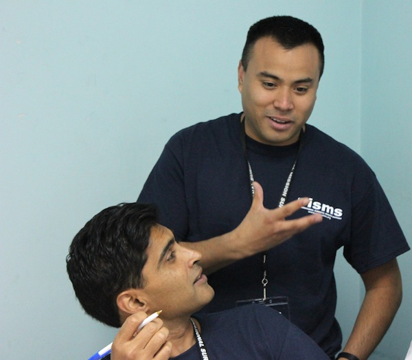 Enrique, our Operation International translator, helps the urologists converse with the local doctor.