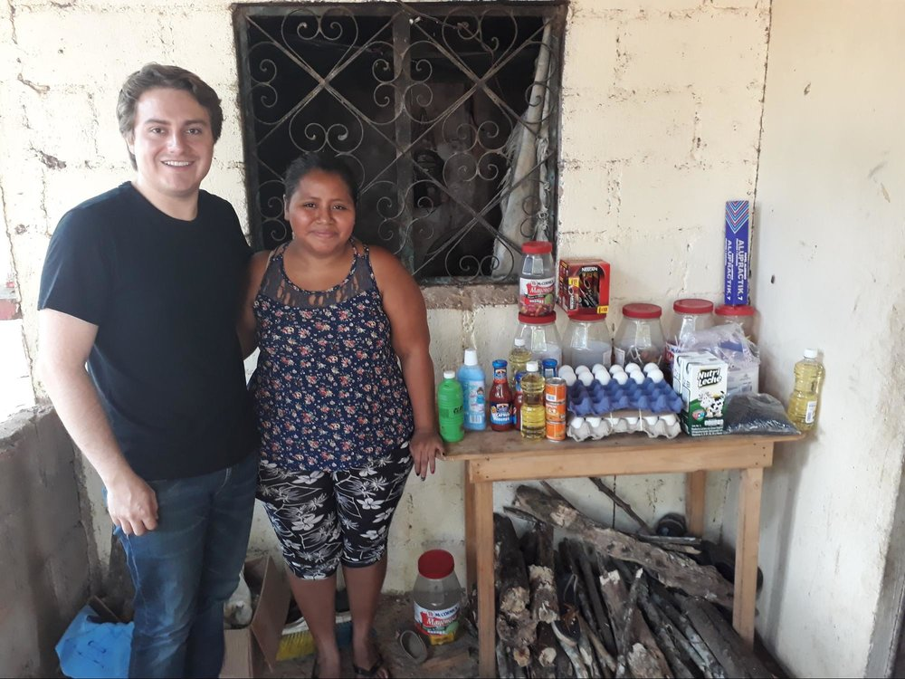 Gerardo snags a picture with one of the applicants we met and her business, a stand selling eggs, candy, and other sundries. The small scale of some businesses we encountered, such as the one pictured above, reinforces their need for access to financial products. This woman's entrepreneurial endeavors are only limited by the capital she can acquire.